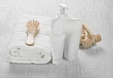 White set with hairbrush and massager Royalty Free Stock Image