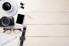 White set. Pen, eyeglasses, coffee and notebook on table. Top view.  Stock Photography
