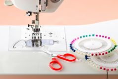White Sewing machine and sewing supplies. Work process stock images