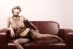 White sexy woman playing on sofa Stock Photo