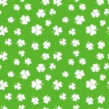 White shamrocks vector seamless pattern. White shamrocks on green background vector seamless pattern Stock Photo
