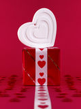 White shape heart over gift box Stock Photography