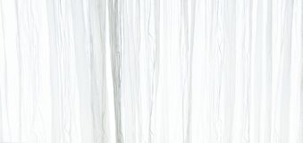 White sheer curtain texture background in daylight atmosphere of apartment`s interior. White transparent curtain Stock Photos