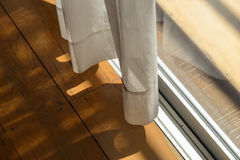 White sheer curtains with bright sunlight and wooden floor. Royalty Free Stock Photography