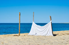 The white sheet on a background of blue sea. Stock Photo