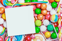 White sheet on candy and sweets Stock Images