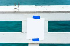 White sheet glued to white wooden crossbar, Malibu, California, USA. With selective focus. Frame for text.  stock image