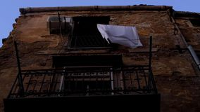 White sheet hanging on a balcony stock footage