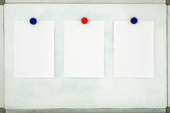 White sheet of paper attached to the old dirty magnetic board wi Stock Image