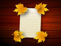 White sheet of paper with autumn leaves Royalty Free Stock Images