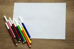 White sheet of paper, colored felt-tip pens Royalty Free Stock Photos