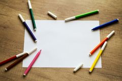 White sheet of paper, colored felt-tip pens Stock Photography