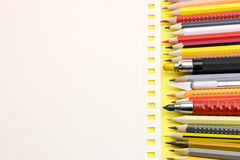 White sheet of paper with different school supplies on yellow ba Royalty Free Stock Photos