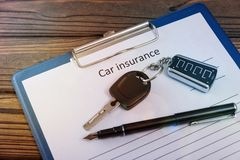 Car insurance, car keys, on a wooden background. royalty free stock images