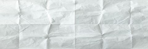 White sheet of paper folded. Crushed and folded white sheet of old paper. Note paper. Wrinkled paper Royalty Free Stock Images
