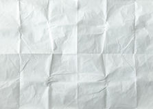 White sheet of paper folded. Crushed and folded white sheet of old paper. Note paper. Wrinkled paper.  stock photography