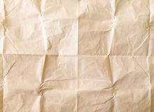 White sheet of paper folded. Crushed and folded white sheet of paper. Note paper. Wrinkled paper Stock Image