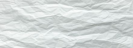 White sheet of paper folded. Crushed and folded white sheet of paper. Note paper. Wrinkled paper.  stock images