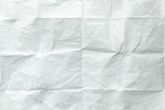 White sheet of paper folded. Crushed and folded white sheet of paper. Note paper. Wrinkled paper Stock Photos