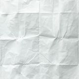 White sheet of paper folded. Crushed and folded white sheet of paper. Note paper. Wrinkled paper Stock Images