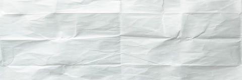 White sheet of paper folded. Crushed and folded white sheet of paper. Note paper. Wrinkled paper Royalty Free Stock Photo