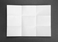 White sheet of paper folded in nine top shooting. Royalty Free Stock Photo