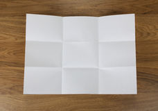 White sheet of paper folded in nine top shooting. Royalty Free Stock Image