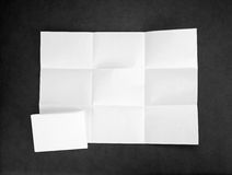 White sheet of paper folded in nine top shooting. Stock Images