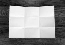 White sheet of paper folded in nine top shooting. Royalty Free Stock Photography