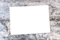 White sheet of paper on the oak brown  table Stock Image