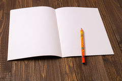White sheet of paper and a pencil Royalty Free Stock Photo