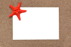White sheet of paper with a starfish Royalty Free Stock Photography