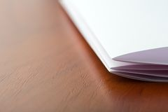 White sheet of paper on the table Royalty Free Stock Photo