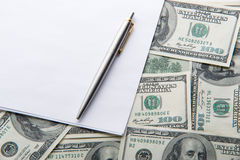 White sheet and pen on the money Stock Image