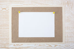 White sheet on textured paper Stock Photography