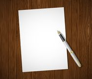 White sheet on a wooden table Stock Image
