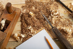 White sheet on wooden table for carpenter tools with sawdust. Copy space. Top view Stock Images