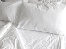White Sheets. Detail of bed with set of crisp white sheets and pillows Royalty Free Stock Photo