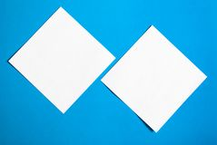 White sheets of paper on a blue background stock photo