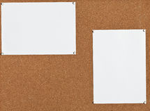 White sheets of paper on cork board Stock Images