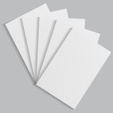 White sheets of paper on a gray background Stock Photo