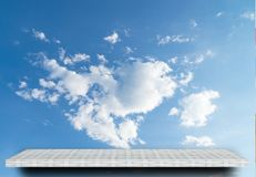 Shelf display counter on cloud sky background royalty free stock images