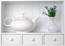 White shelf with vintage porcelain tableware Royalty Free Stock Image