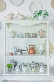 White shelf with vintage porcelain tableware Royalty Free Stock Photos
