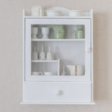 White shelf with vintage porcelain tableware Stock Photo