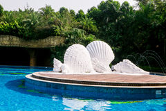 white Shell conch foam sculpture swimming pool outdoor decoration setting  Stock Photo