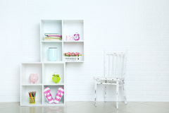 White shelves. On a brick wall background royalty free stock photos