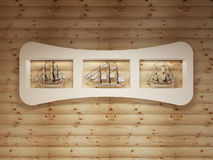 White shelves with niches with models of sea vessels on the log Stock Photos