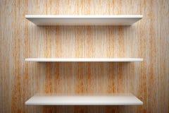 White shelves on wood wall Stock Photos