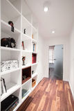 White shelves and wooden floor Stock Photos